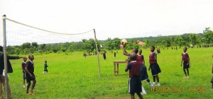 Boys and girls playing volleyball at Little Angels School, Ichama, Nigeria