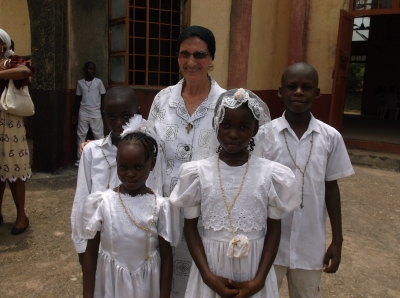 Girls wear dresses donated by Sr. Barbara's neices