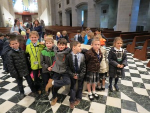 Happy children at baptismal font